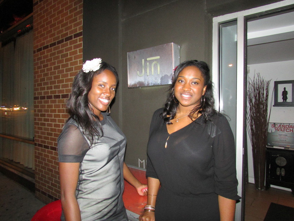 Breonna and friend greeting at the door of Jin, I love the flower. Pretty girls with great smiles!