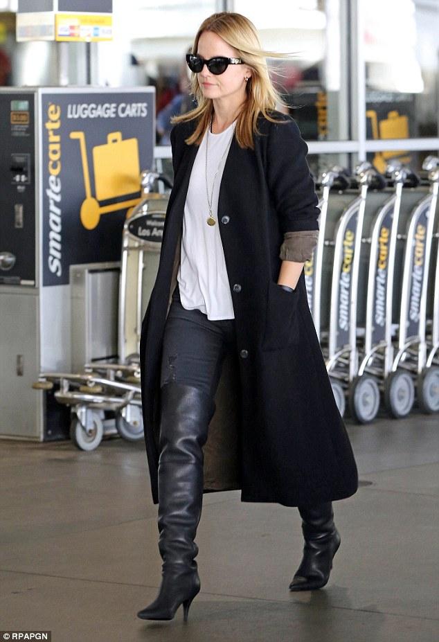 Mena Suvari paired her OTK's with denim, basic tee, and a long coat