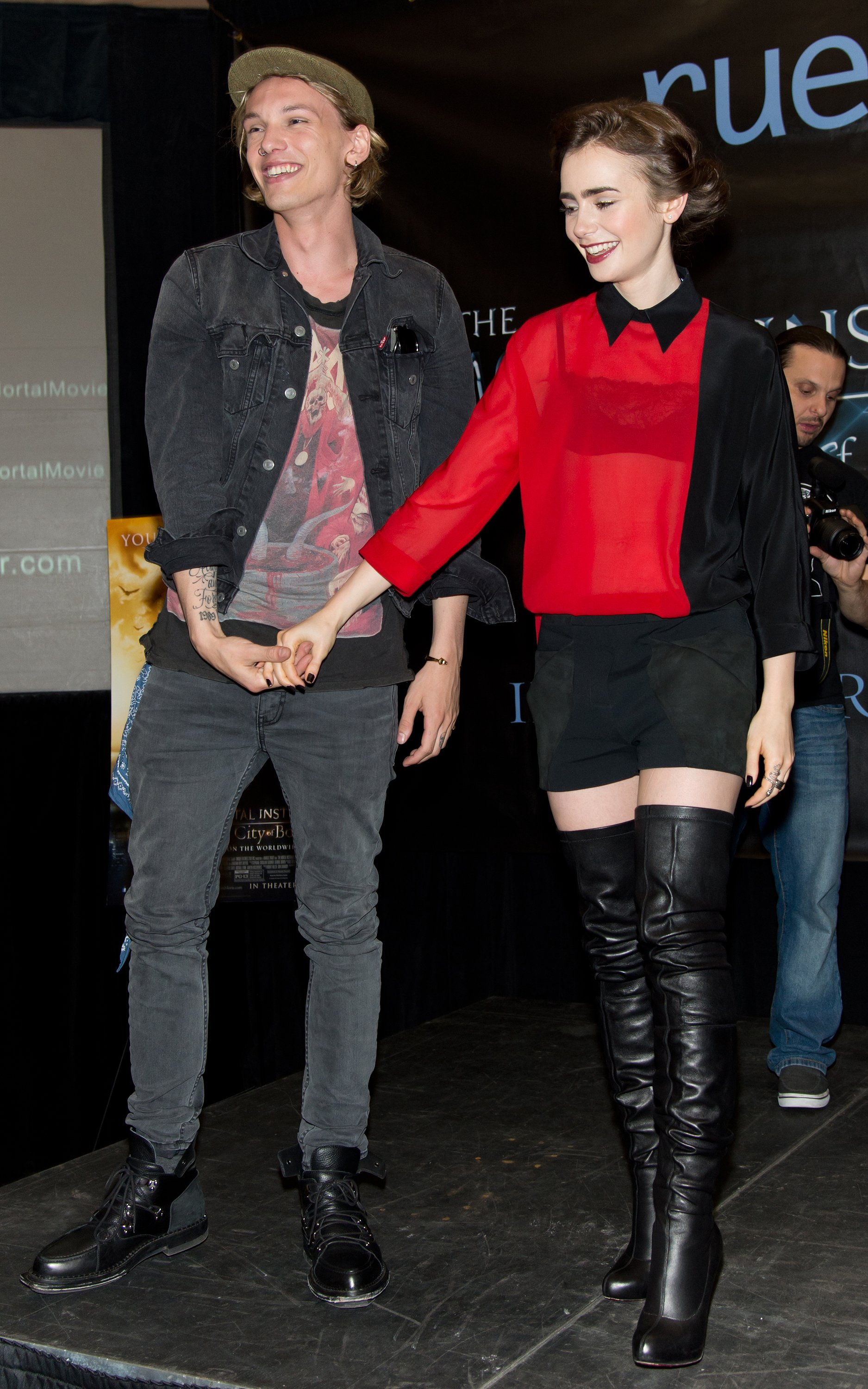 Lily Collins paired her black OTK's with a mini and a colorblocked oversized top