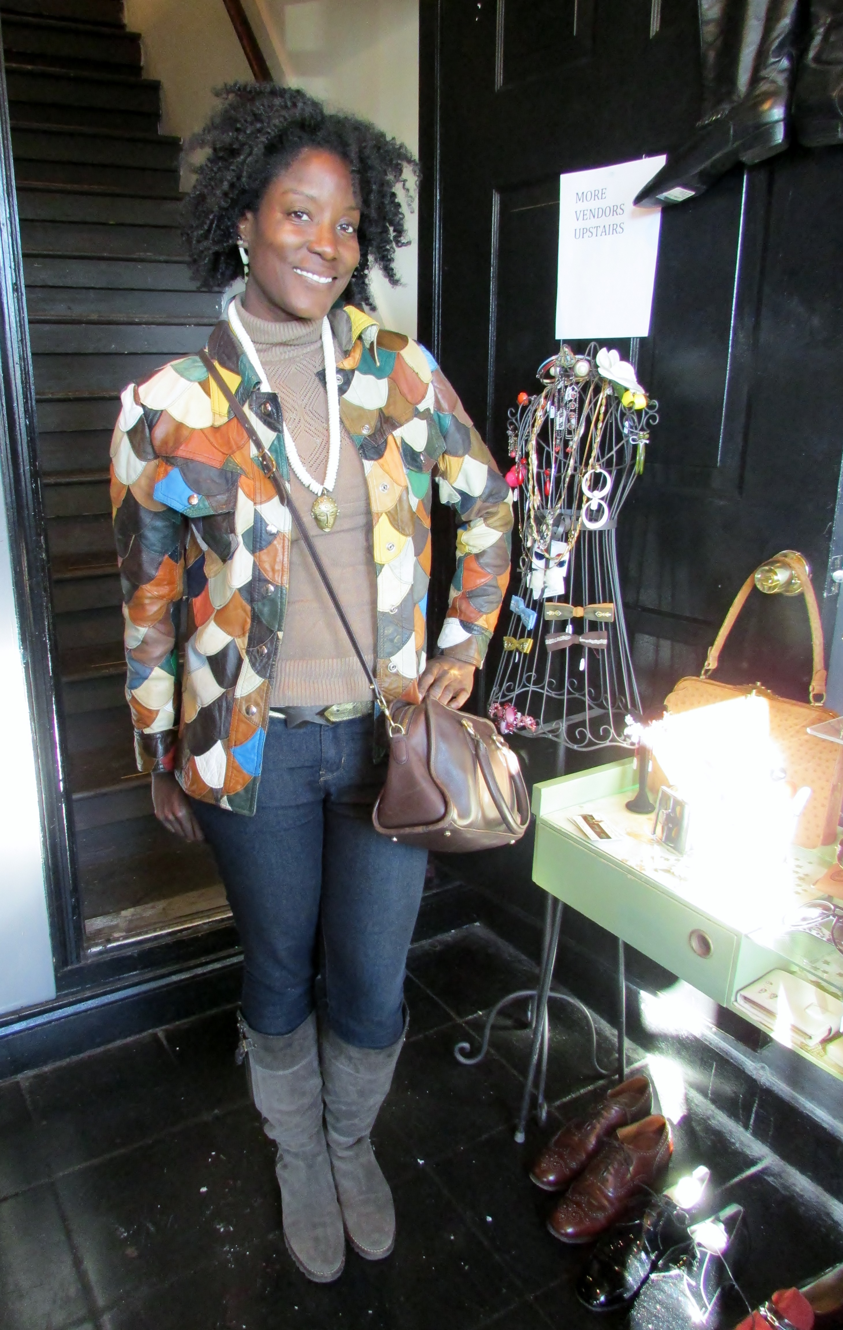 Her jacket! Vintage at it's finest. Patchwork leather, ultimate throwback!