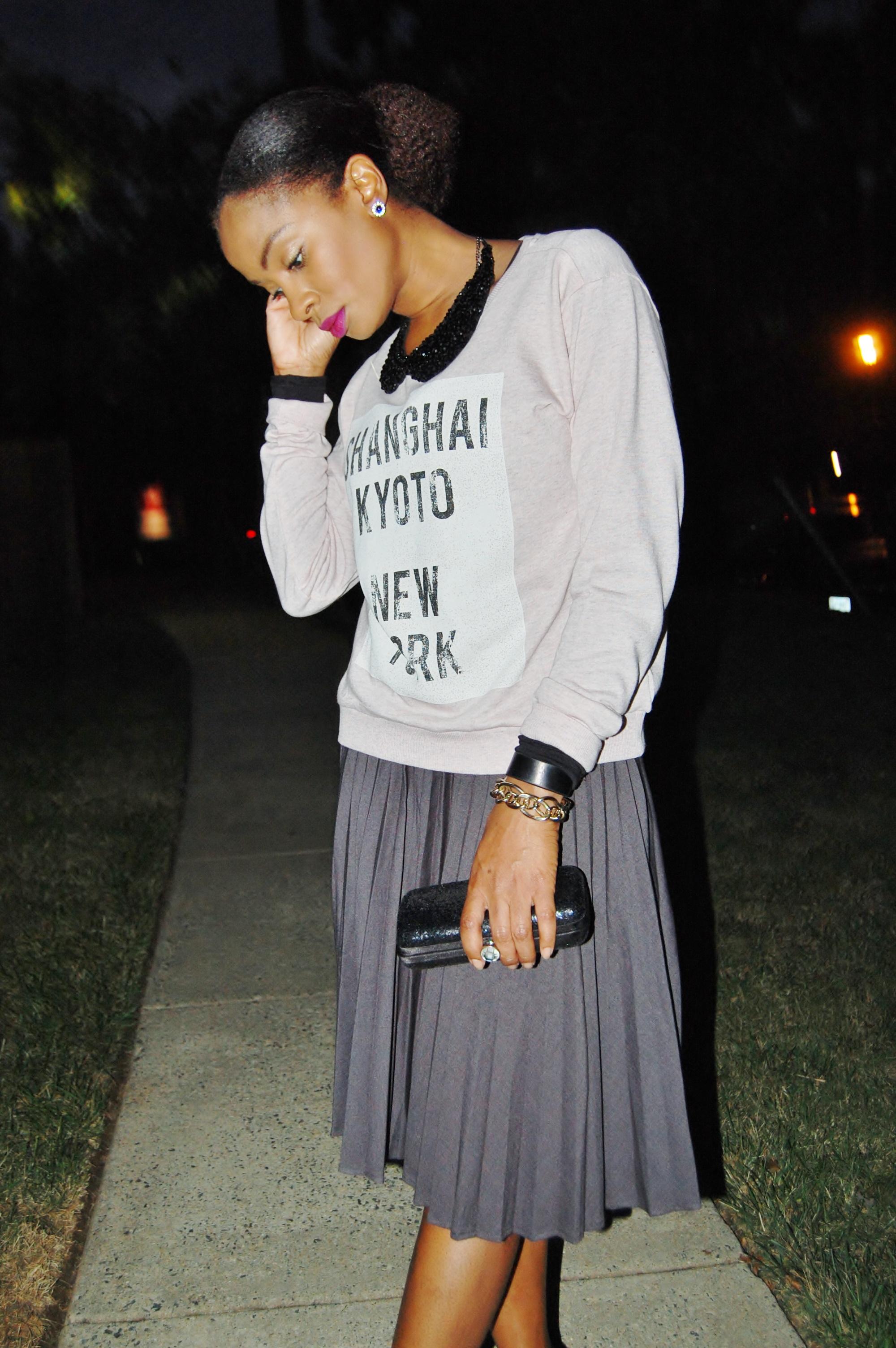 Yana B. Graphic sweatshirt with grey pleated skirt